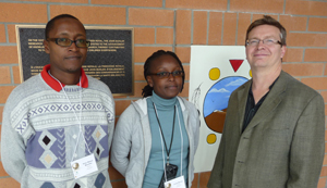UofM Bulletin pic during the 2010 Symposia Meet & Greet, April 26, 10. Trainees Peter Maturi Mwamba and Cisily Meeme, with Dr. Keith Fowke, Principal Investigator.